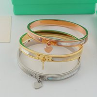 Wholesale Pearl Bangles Designs - Hot sale Classic Design 316L Titanium steel punk lovers bangle with nature shell and heart pendant for Women bangle in 5.7cm jewelry gift f