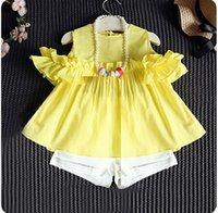 ingrosso vestito giallo per bambino-2018 nuove neonate che coprono gli insiemi i bambini di estate hanno messo le felpe di cotone gialle + i pantaloncini bianchi ansimano il vestito 2pcs