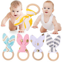 Wholesale pc intelligence - 1 Pc Baby Toy Soft Little Rabbit Ears Wooden Hand Grasp Toy Rattles Develop Baby Intelligence Grasping Hand Bell Rattle