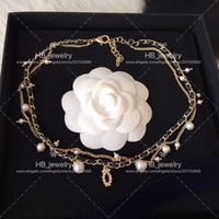 diseño de joyas collar de perlas al por mayor-La popular marca de moda Pearl Chokers Necklace for lady Design Women Party Wedding Lovers regalo de novia Joyería de lujo para la novia con caja.