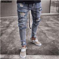 ingrosso pantaloni da jogger-Progettista di marca Slim Fit Jeans strappati Uomini Hi Street hip hop Pantaloni da uomo Denim Pantaloni da jogging Pantaloni Fori lavati Jeans distrutti