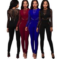 ingrosso bodysuit nero stretch-Tuta aderente con cerniera sul retro. Tuta aderente con cerniera nera e blu
