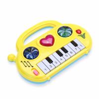 ingrosso il bambino gioca la musica a colori-Kids Music Toy Bambini Musical Developmental Mini Piano Portable Sound Apprendimento musicale Musica Funny Toy Baby Color Casuale