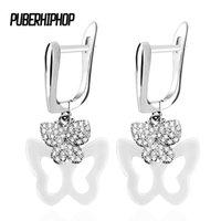 conjuntos de joyas de cristal de corea al por mayor-Pendientes colgantes de mariposa con Bling Cristal Negro Blanco Cerámica Moda Temperamento Pendientes de Corea Joyería de moda