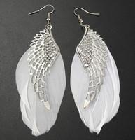 los amuletos del ala cuelgan al por mayor-Pendientes de plumas DHL Lady Cute Fashion Jewelry Angel Wing Charm Light Silver Dangle Eardrop para mujeres Regalo de Navidad