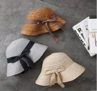 Wholesale grass shades resale online - The new summer straw hat lady han version of the forked bowknot shading hat with a stylish fisherman s hat