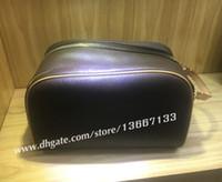 sacos de higiene pessoal venda por atacado-Frete Grátis Designer de Moda dos homens de Viagem saco higiênico Couro Genuíno de grande capacidade sacos de cosméticos bolsa de maquiagem bolsa de higiene para as mulheres
