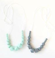 dentiers sûrs achat en gros de-Nuby dentition collier bébé à croquer collier de dentition sûr silicone sans BPA collier de perles pour Mama Monochrome Fashion bijoux