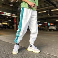 pantalones hip hop hombre venda por atacado-Moda hip hop calças dos homens lace up corredores calças soltas calças streetwear mens sweatpants pantalones de hombre