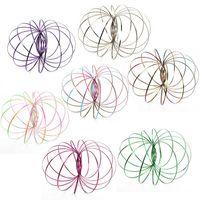 jouets en mouvement achat en gros de-Anneau de flux coloré en métal jouet 6 couleurs holographique par mouvement tout crée un anneau de jouets cinétiques