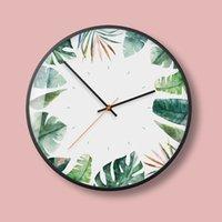 зеленые часы оптовых-Свежие, зеленые листья, немой, изысканные настенные часы, Северный зеленый завод, современный европейский стиль гостиной, настенные часы.