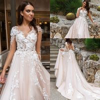 Wholesale design back covers - 2018 Pearl Pink Illusion Design Wedding Dresses Crystal Lace Appliques Long Sleeves Sexy Back With Covered Button Bridal Gowns