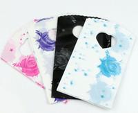 schwarze plastikschmucksachegeschenkbeutel großhandel-100 stücke 4 Farben Rosa Blau Schwarz Lila Sterne Rose Plastiktüte Geschenktüten Schmuckbeutel 15X9 cm GB002
