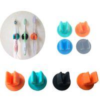 tipos de pasta de dientes al por mayor-Soporte de cepillo de dientes de silicona con adhesivo adhesivo de 3M Mini soporte de montaje en pared Soporte de bastidor resistente Gadgets de baño para el hogar