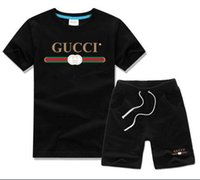 trajes de uniforme para niñas al por mayor-2018 Nueva ropa para niños Niños y niñas Camiseta de verano Pantalones cortos Conjunto de traje deportivo Niños Niño Bebé Niños Uniforme escolar de moda Traje