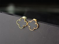 Wholesale top china fashion jewelry for sale - Group buy Top Quality Celebrity design Women Letter Clover Stud Earrings Fashion Metal Flowers Opal Earring Jewelry With Box