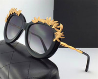 Wholesale flower sunglasses - New fashion designer sunglasses 0316 cat eyewear frame with metal flower avant-garde summer style uv400 protection eyewear for women