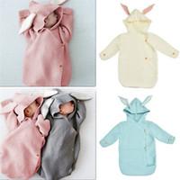 neugeborene großhandel-74cm Newborn mit Kapuze Swaddle Wrap Baby Kaninchen Ohr stricken Windeldecke warme Wolle Kleinkind Schlafsack 4 Farben 55PCS AAA1185