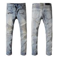 ingrosso chiusure lampo nere di jeans-Jeans da uomo Nuovi jeans firmati Biker da motociclista Jeans skinny 100% cotone rivetto Pantaloni da uomo con cerniera crimine alla moda Jeans strappati strappati neri