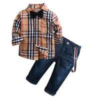 camisa de corbata para niños al por mayor-Toddler Boys Trajes de diseño Otoño Niños Falda Jeans Conjunto de ropa Niños Plaid Bow Tie Camisa de manga larga + pantalones de liga 2pcs set Y863