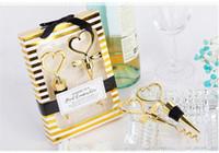 bodas de oro rojo vino al por mayor-2018 Corazón de oro en forma de corazón Juego de vino rojo Tapón de vino Sacacorchos Saludos a una gran combinación Favor de la boda Regalos de fiesta