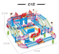 pistas de plástico del coche al por mayor-C1 Nuevos juguetes ferroviarios de qumitoys train track coche eléctrico Bebé juguetes educativos de plástico juguetes de inteligencia
