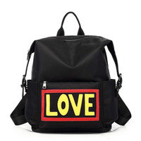 Wholesale designer named bags resale online - 2colors choose devil s name waterproof Oxford fabric love fashion backpacks school bags designer backpack shouler bag for travel and school