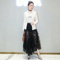 marfim, chão, comprimento, anágua venda por atacado-2018 moda feminina ruffles saias longas ver através de saias da marca saias de grife preto