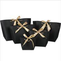 ingrosso abbigliamento scatola marrone-21x7x17cm Sacchetto di carta colorata con manico Cute Bow Ribbon Black Gift Bag per la festa di Natale
