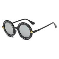 KOKO rétro lunettes de soleil rondes lettres anglaises petites lunettes de  soleil d abeille hommes et femmes marque lunettes designer mode hommes et  femmes a0ec8fe6142e
