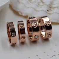 розовые циркониевые кольца оптовых-Европейская и американская мода любовь Циркон кольцо пара моделей винт титана стальное кольцо пара розовое золото женщин кольцо