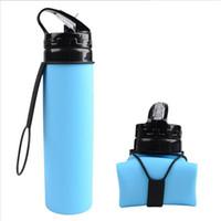 botellas de plástico plegables al por mayor-Botella de agua del deporte de la categoría alimenticia 600ML bebida de silicona plegable plegable plegable que acampa viaja mi bicicleta de plástico B1955