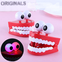 Wholesale Cute Cartoon teeth Clockwork Toys Wind Up Light emitting teeth toys lovely ornaments Classic Toy For Children Gift Jump teeth H1457