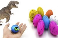 dinosaurio inflable de agua al por mayor-2018 juegos de la novedad 60pcs dinosaurio mágico inflable de la ecología agregue el agua que crece los huevos de Dino el juguete del niño del niño