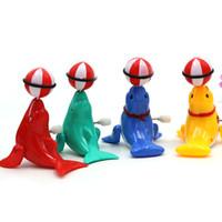 acabar com os animais venda por atacado-Lovely Dolphin Clockwork Toy Multi Color Plastic Animal Shape 360 Degrees Rotation Wind Up Brinquedos Hot Sale 1 5fd W