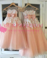 Wholesale peach tulle wedding dresses - 2018 New Peach Tulle Flower Girls Dresses Sheer Jewel Neck A Line White Appliques Waist With Bow First Communion Dresses Custom Made Cheap