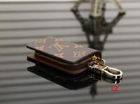 monedero llaveros al por mayor-2019 diseñador de lujo hombres mujeres monedero llave del coche clave carteras bolsa Francia famoso Canvers a cuadros coche llavero anillo