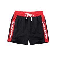 828ed0070c Wholesale cotton surf shorts for sale - new summer beach men shorts solid  color cotton casual