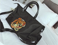 Wholesale Tiger Stripe Bag - New luxury brand SUP AAPE YEEZUS embroidered tiger head travel bag Oxford cloth waterproof Oxford fitness bag boarding bag