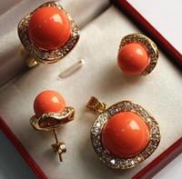conjuntos de perlas de 14mm al por mayor-La joyería noble de la venta al por mayor libre del envío fijó la perla anaranjada de la cáscara de 18KGP + 12-14mm, pendiente pendiente del perno prisionero