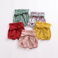 lindos pantalones cortos de color caramelo al por mayor-Cute Toddler Baby Girls Floral Plaid Bow Ruffles Pantalones PP Pantalones cortos de verano Multi Candy Color Rosa Rojo Azul Color Beach Wears