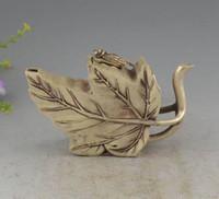 hoja de oro de china al por mayor-Tetera de diseño biónico de la hoja de arce de plata Miao de China