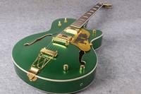 landgitarren großhandel-Gre Falcon G6120 Metallic Grün Chet Atkins Country Jazz Semi Hollow Body E-Gitarre Pearloid Buckel Block Inlay Gold Trapeze Saitenhalter