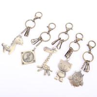 llaves de jirafa al por mayor-Oso Jirafa Caballo jirafa Llavero Mujeres Llaveros Coche Búho Llavero de metal para llaves