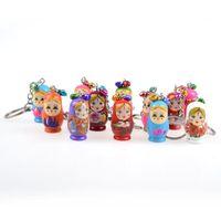 puppenschlüsselanhänger großhandel-Originalität kleines Geschenk Schlüssel Kette Zeichentrickfiguren handbemalt Holz russische Puppe Schlüssel Schnalle niedlichen Puppet Charm Anhänger Schlüsselanhänger 0 9tw jj
