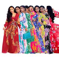 elegantes europäisches amerikanisches kleid großhandel-Kleid der beiläufigen Frauen der Art und Weise tiefes V langes Hülsen breathable Chiffon- eleganter Klassiker zehn Farben europäischer und amerikanischer Druckstrandrock