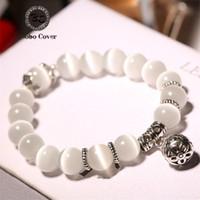 weißer katzenaugenanhänger großhandel-Heißer Verkauf weiße Cat Eye Perlen Armband mit Glück Anhänger Charms Strang Armband Für Frauen Mode Stein armbänder