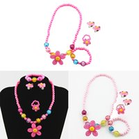 Wholesale baby beaded necklaces - 4pcs Kids Baby Girl Imitation Pearls Beaded Sun Flower Necklace Bracelet Rings Earrings Decoration Jewelry Set Children Party Baby Gifts