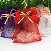 горячие розовые банты органзы оптовых-Горячий розовый галстук-бабочка Drawable Красный органзы ювелирные сумки 9x12cm 30 шт. Небольшой пользу свадебный подарок упаковка сумки упаковка ювелирных изделий мешки
