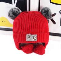 Wholesale baby knitted cowboy hats resale online - New double hair ball baby hat winter warm earmuffs wool caps men and women baby plus velvet knit hat